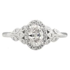 Vintage Oval Halo Engagement Ring with rustic diamond leaf detail by Emily Chelsea Jewelry