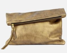 Oversized Metallic Fold Clutch. Versatility is everything, and this clutch will have your bases covered no matter where you are.