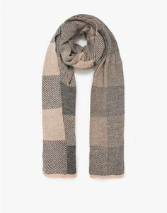 From A Peace Treaty, a ultra soft handmade lightweight stretch wrap style scarf in blush and grey plaid pattern.  • Handmade lightweight scarf in blush and grey • Plaid pattern • Wrap style • Finished edge • Soft, stretch 100% baby alpaca yarn • Ma