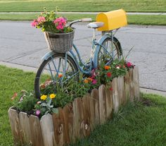 Use an old bicycle to make a fun mailbox planter!