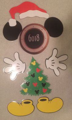 Dress up your Disney cruise stateroom door with this Christmas tree Mickey Mouse body part magnet set.  This set includes -christmas tree with mickey heads -1 Santa hat -2 hands -2 ears -2 shoes  These are made of cardstock and laminated to make for easy travel. Also have a strong magnet on the back so they stay on the doors without falling off.  These are made to fit around the porthole on the stateroom cruise door of the Disney cruise ships Great for fish extenders or perfect souvenir…