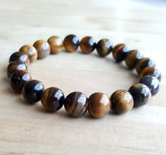 10 mm tigers eye bracelet men women yoga bracelet friendship bracelet Healing Protection bracelet Bracelet Wedding gift birthstone B200 by OrientAppeal on Etsy