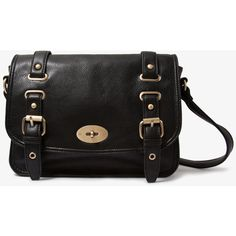 A faux leather satchel featuring two decorative buckle straps. Turn-lock closure. Buckled crossbody strap. Matte hardware. Interior zipper placket. Interior zi…