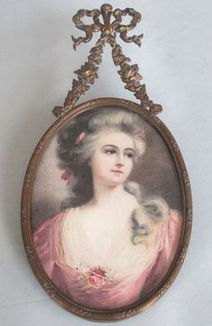 Antique Miniature Portrait Set In A French Gilt Brass Ormoly Frame Suspended From Swags Of Roses And Flowers With A Flowing Bow At The Top    c.1850-1899