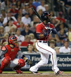 Atlanta Braves' Jason Heyward (22) follows through with a solo home run during the fifth inning as St. Louis Cardinals catcher looks on