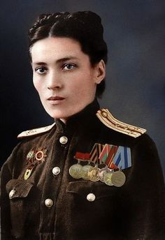 "Colorizing portraits of Soviet military men and women was often done with meticulous attention to hues and ""true"" colors as in the case of this portrait of an unidentified Red Army female officer."