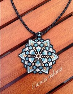 Mandala peyote graphic flower pattern, photo only. Beaded Jewelry Designs, Seed Bead Jewelry, Bead Jewellery, Jewelry Patterns, Handmade Jewelry, Peyote Stitch Patterns, Seed Bead Patterns, Beading Patterns, Beaded Crafts