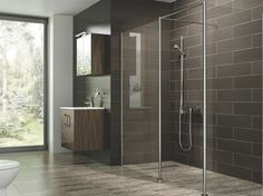 A contemporary bathroom can be safe using a one level shower design. Check out this article about the pros and cons of walk in showers.
