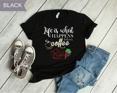 0b62eb4094f Life Happens Between Coffee and Wine T-Shirt