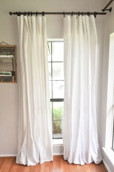 How to Make DIY No-Sew Bleached Drop Cloth Curtains without making your house smell like a pool. This method uses a bleach solution and a vinegar solution outside! You will finish bleaching your drop cloths in the washing machine for a gorgeous, soft, textured Farmhouse or cottage style look. It will instantly make your home decor light and bright. - Our Handcrafted Life