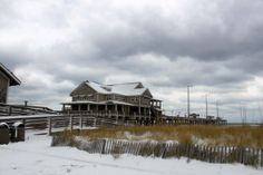 Jennette's Pier covered with a light dusting of snow in Nags Head, NC. :: January 29, 2014 :: #SnOBX