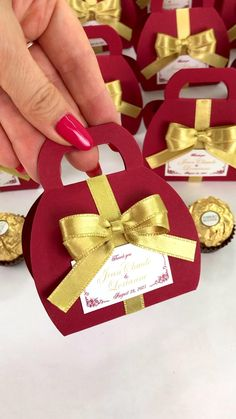 Burgundy wedding favor box with gold satin ribbon bow and custom names, Elegant personalized bonbonniere make a unique way to thank guests for attending your special day. #welcomebox #giftbox #personalizedgifts #weddingfavor #weddingbox #weddingfavorideas #bonbonniere #weddingparty #sweetlove #favorboxes #candybox #elegantwedding #partyfavor #redwedding #burgundywedding #giftboxes #uniqueweddingfavors #uniqueweddingideas #goldwedding Candy Wedding Favors, Beach Wedding Favors, Wedding Favor Boxes, Unique Wedding Favors, Party Favors, Wedding Gifts, Destination Wedding Welcome Bag, Wedding Welcome Bags, Luxury Packaging