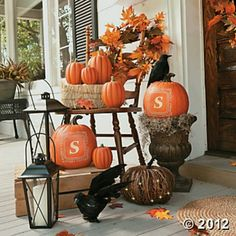 Fall porch decor - pumpkins painted with last name initial