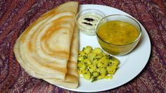 Dosa is a popular South Indian delicacy which looks like a crepe. Dosa is a crisp and thin pancakes made of a rice and urad dal batter. Traditionally Dosa is served with samber, aloo masala and coconut chutney.