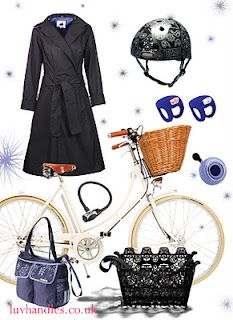 Women's bike fashion with Classic Pashley Brittania bicycle, WODB Mac, Nutcase helmet, Knog frog strobe lights, Electra ding dong bell, Kryptonite coil lock, and single Basil pannier/handbag.