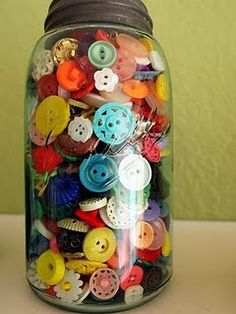 Mason jar full of buttons...I would love to sort through these!