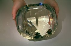 A faceted topaz weighing 22,892.50 carats, making it the largest cut yellow topaz in the world, as well as one of the largest faceted gems in the world, period.