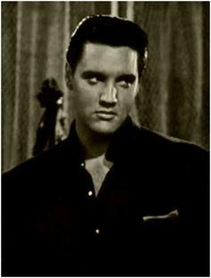"""Elvis during scene of singing """"Return to Sender"""" in the film """"Girls, Girls, Girls""""."""