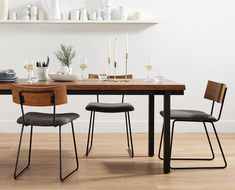 Complete your rustic industrial dining room with the Karsten dining chair. Sleek black metal shapes the connected base. Wood backrest and cushioned seat.