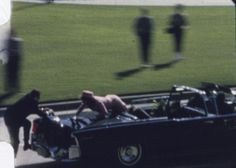 Abraham Zapruder, using a Bell & Howell Zoomatic, briefly lost sight of the presidential limousine as it drove through Dallas, but it came into view just before the fatal shot was fired. In Frame 375, first lady Jacqueline Kennedy crawled toward the back of the car and Secret Service agent Clint Hill scrambled to help her. Friday advance. (CREDIT: Zapruder Film ©, The Sixth Floor Museum at Dealey Plaza)