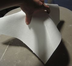 Folding fiber paper for a floral former. Floral former using terracotta pot and fibre paper.