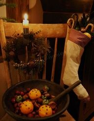 Primitive Christmas...the cloves in the oranges reminds me of my dad and my childhood. .. ♥