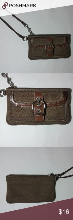 "Coach Brown Small Signature Clutch Wristlet Cute preowned Coach small brown signature clutch wristlet in good condition.  Measures approx: H 4"" x L 7"". Strap drop 6 1/2"".  Preowned with normal use. Shows dark spots and wear on the bottom edge corners of wristlet, but just need to be cleaned. Also shows darkening of the leather strap. Does not come with a hangtag. Overall it is still a lovely cute wristlet for any occasion. Thanks for looking! Coach Bags Clutches & Wristlets"