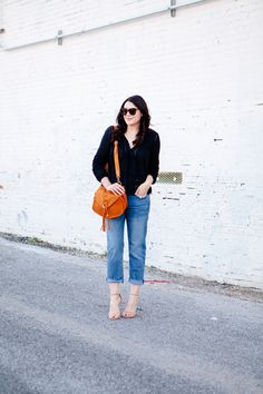Black eyelet top paired with boyfriend jeans on Kendi Everyday