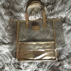 Michael Kors tote! Large clear Michael Kors tote with gold accents ! New used brand new!! Great for the beach(: will take offers Michael Kors Bags Totes