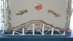 Almost Unschoolers: Summer Fun Day 58 - Cardboard Roller Coaster Craft- this would be a great addition to a Physics study!