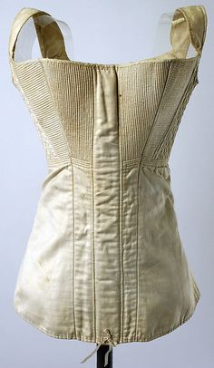 Corset Date: 1820s Culture: European or American Medium: cotton Dimensions: Length at CB: 15 1/2 in. (39.4 cm) Credit Line: The Jacqueline Loewe Fowler Costume Collection, Gift of Jacqueline Loewe Fowler, 1982 Accession Number: 1982.82.3