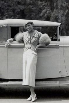 Whip Appeal | 1934 Josephine Baker standing besides her brand new ride, a 1934 French Delage D8-15 cabriolet. [click images to enlarge]