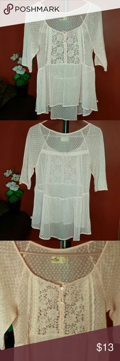 Hollister sheer top with crochet front Pretty in pink!! This absolutely adorable sheer hi/low Hollister  top with delicate crochet center with buttons is like new! Hollister Tops Blouses