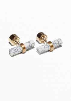 Elegant brass earrings featuring a genuine stone bar with a marble-looking finish.