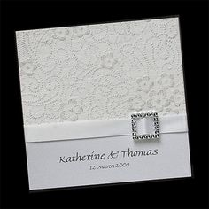 "Inspiration Card.   6"" x 6"" square invite with lace embossing on top, ribbon border in navy, silver bow or other embellishment, names at bottom with wedding date."
