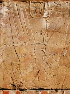 Detail from the Temple of the Goddess Sati on the Yéb -Elephantine Island. The Goddess Sati embracing King Thutmosi III (wearing the Two Feathers Crown with ram's horns and the Solar disk with bull's horns)