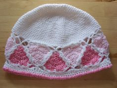 http://www.ravelry.com/patterns/library/hearts-go-round-hat
