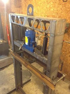 """Shop Press by eleventhgen -- Homemade shop press constructed from channel steel and powered by a 50-ton hydraulic/pneumatic jack. Features a 3"""" width capacity. http://www.homemadetools.net/homemade-shop-press-13"""