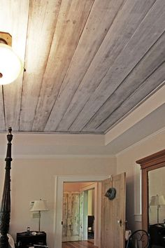 Repurposed barnwood on master br ceiling, gives it a sense of history.