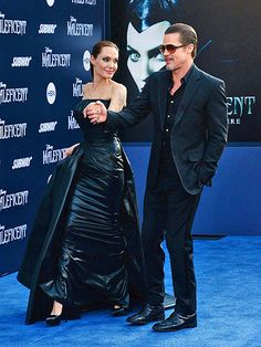 DATE-NIGHT CHIC Angelina Jolie and Brad Pitt make for a magnetic couple as they sweep the Maleficent premiere outside L.A.'s El Capitan Theatre on Wednesday. The two remained cool even after Pitt was attacked by a Ukrainian TV presenter while signing autographs for fans.