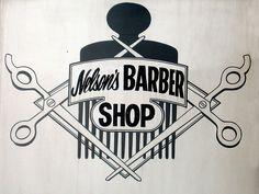 Black and white barber shop sign