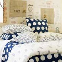 love the mix of patterns on this bed...paisley, polka dots, and the lovely bird pattern on the pillows