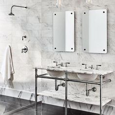 A dreamy master bath with a unique shower design. White marble field tile from floor to ceiling creates a dramatic look and feel, paired with traditional bath fittings (faucet and shower components). Gray and white bathroom design. Waterworks Bathroom, Bathroom Faucets, Bathrooms, Bathroom Closet, Sinks, Small Bathroom, Bathroom Ideas, Wooden Magazine Rack, Traditional Baths
