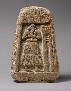 Stele of Ushumgal,Among the earliest written documents from Sumer are records of land sales or grants, often carved in stone with associated images, perhaps for public display.  The Sumerian inscription on this stele records a transaction involving three fields, three houses, and some livestock. Ushumgal, a priest of the god Shara, and his daughter are the central figures of the transaction,