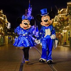 Mickey and Minnie Mouse in their 25th anniversary outfits on Main Street USA with the Sleeping beauty Castle in the background in Disneyland Paris DLP 2017 Time to Sparkle