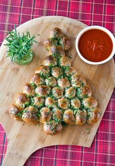 "Because a real Christmas tree just isn't enough. Create this ""Christmas Tree"" Pull-Apart Bread for the holidays."