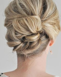 A friend recommended this updo to me after seeing it online and it is really so easy to create and is absolutely beautiful too! To create this look, all you'll be doing is making a teased, loose bun with the bottom section of your hair and securing it with bobby pins, and then taking the top half portion of your hair to create an upside down ponytail before pinning it loosely around into a bun as well. What you end up with is a beautiful hairstyle that looks like you paid major money for it.