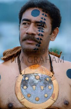Fijian warrior with his face painted in the traditional manner and wearing a breastplate while attending a tribal gathering in Fiji, South Pacific - Photo by Tim Graham