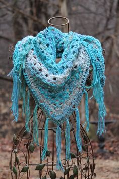 Crazy easy free pattern....triangle shawl. I like to wear more like the cowl look.  The fringe goes well with cowboy boots:) This yarn came from WalMart!