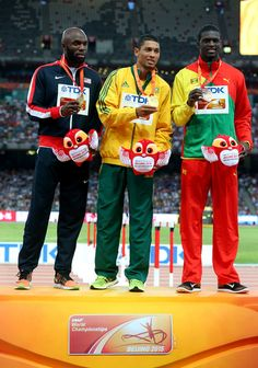 (L-R) Silver medalist Lashawn Merritt of the United States, gold medalist Wayde Van Niekerk of South Africa and bronze medalist Kirani James of Grenada pose on the podium during the medal ceremony for the Men's 400 metres final during day six of the 15th IAAF World Athletics Championships Beijing 2015